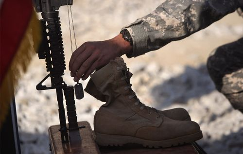 U.S. Army soldier pays his respects at a memorial service for Sgt. John Penich October 23, 2008